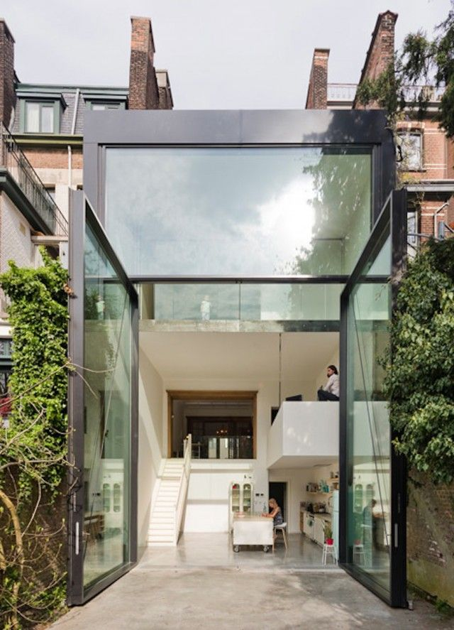 The World's Largest Pivoting Doors in a home by studio Sculp IT
