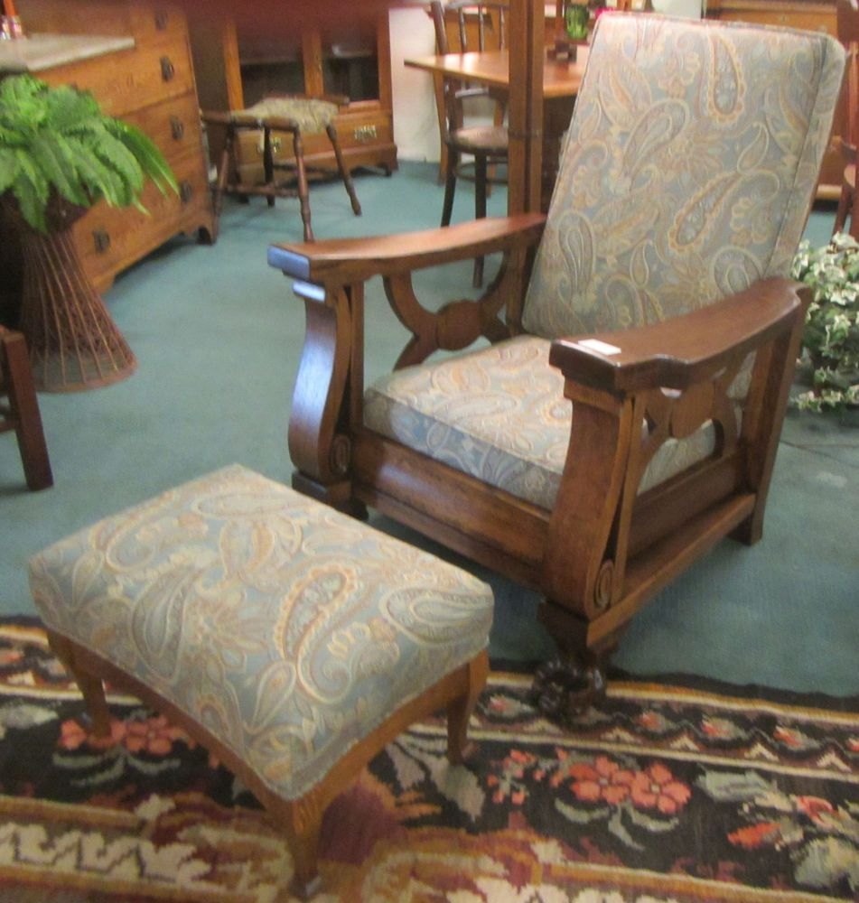 PUSH BUTTON OAK RECLINING MORRIS CHAIR WITH FOOTSTOOL CIRCA 1910. US  $1,995.00