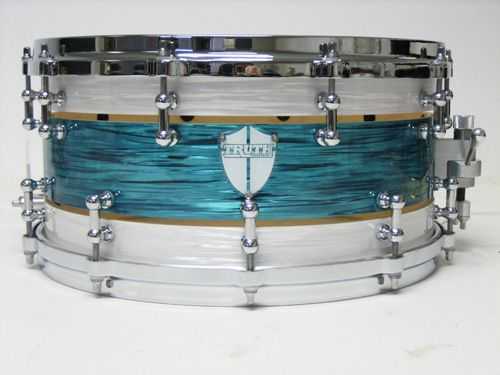 Truth Custom Drums » Some kind of Marine Pearl twist with Teal twist? Could do without the gold strip, but it's not terrible.