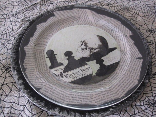 Cathie Filian: Make a DIY Halloween place setting with scrapbook papers and Mod Podge.