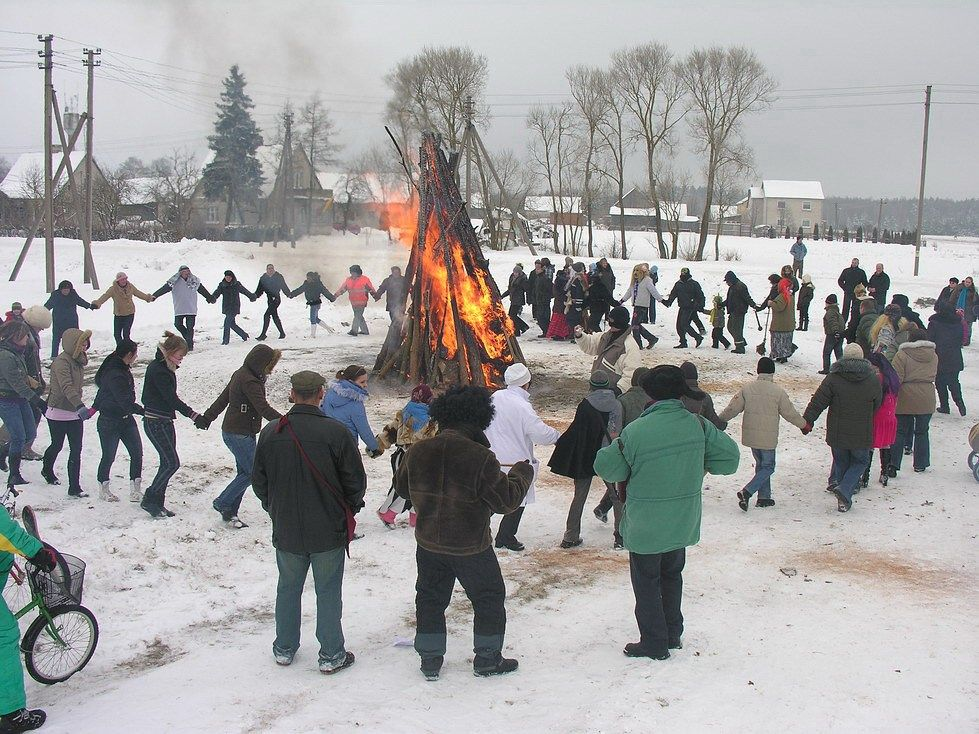 "Uzgavenes - Most of the time people dance around the bonfire, play traditional Lithuanian games, sing various songs. In this way, they are trying to get rid of winter. The two major symbols of this part are the burning of the effigy of winter named Morė and the fight between Lašininis (""porky man"") who represent winter and Kanapinis (""hempen man"") who represents spring. During this fight the hempen man always wins, this way symbolizing the true defeat and the end of winter."