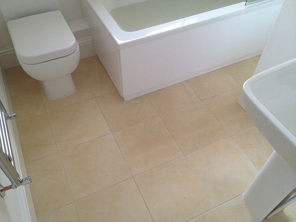 Ceramic Floor Tiles w/ Flexible Grout in a Bathroom Installation in ...