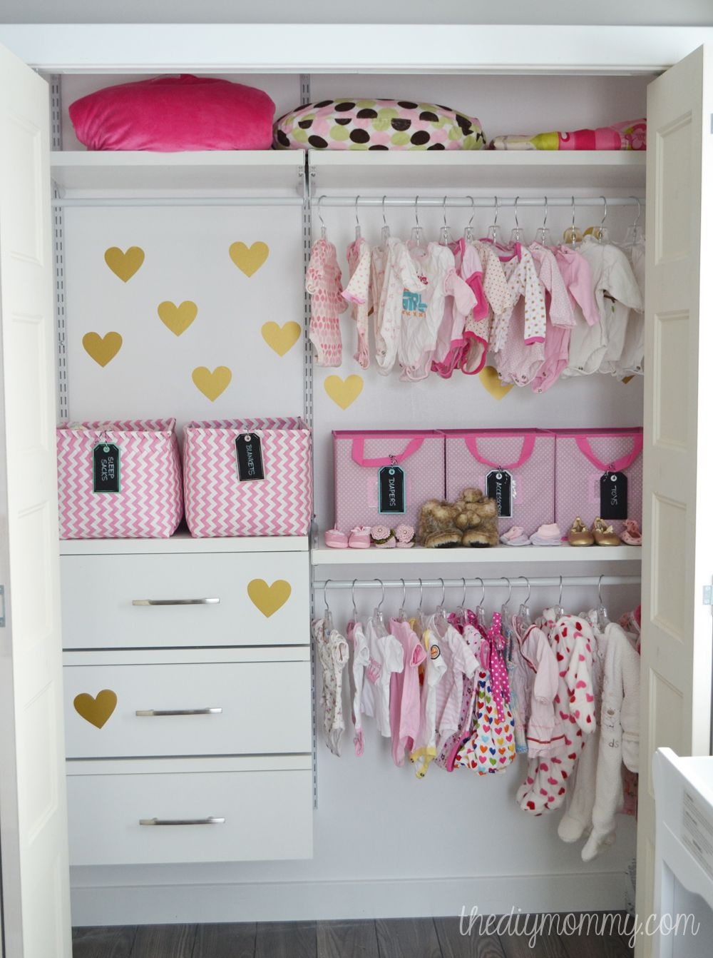 An organized baby closet with closetmaid shelftrack elite for Baby organizer ideas