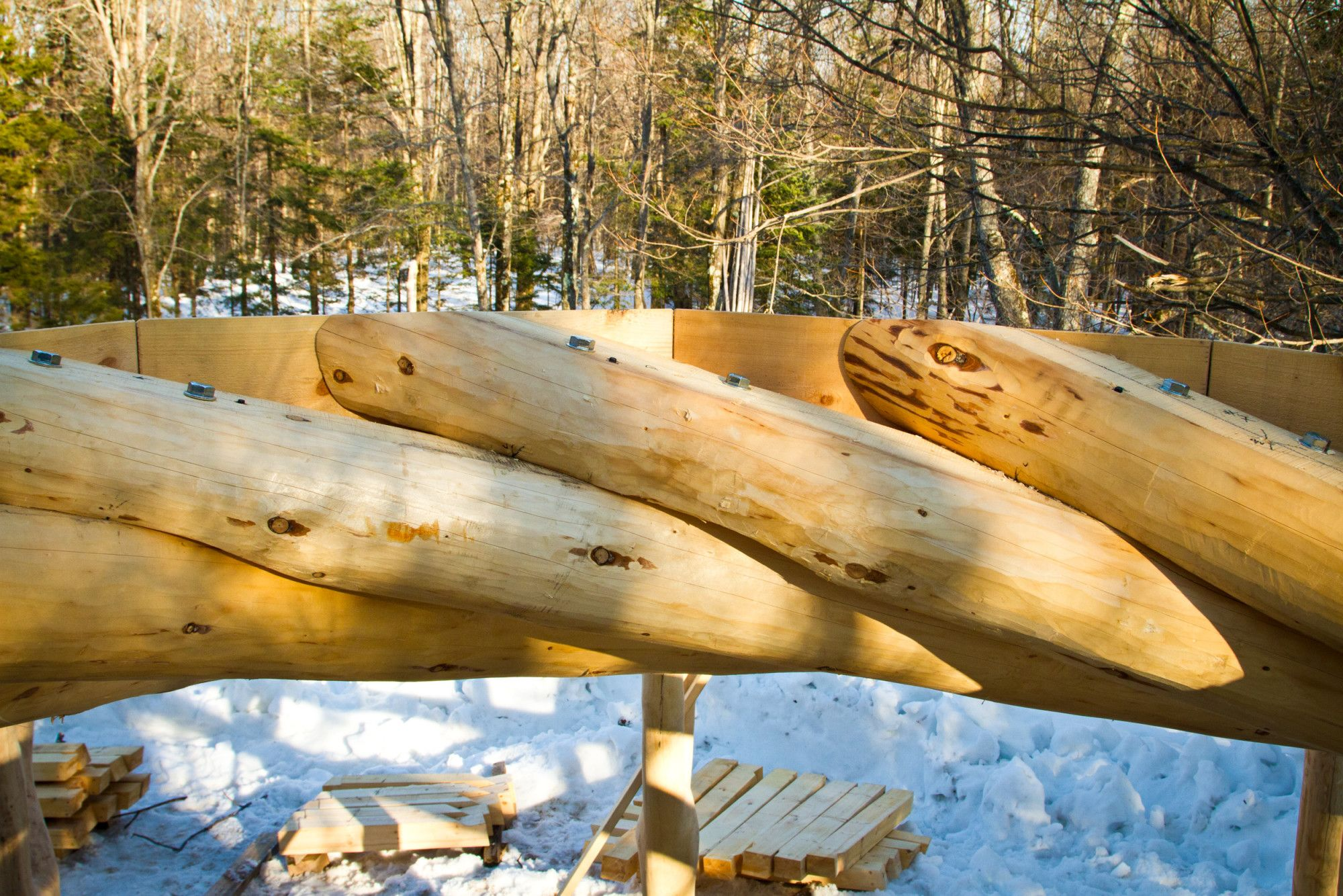 The tips of spruce log rafters rest on one another in this ...
