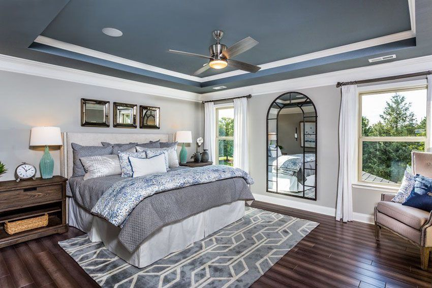 Master Bedroom With Light Gray Walls Painted Blue Tray Ceiling And White Molding With Dark Wood Floors Blue Grey Walls Grey Walls Gray Master Bedroom