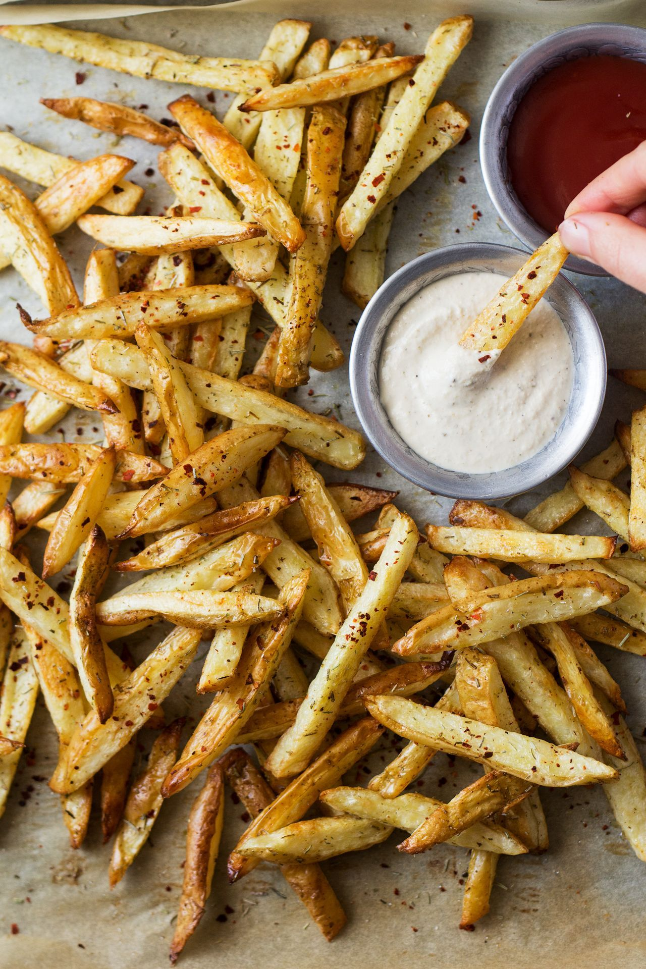 fries with roasted garlic dip These rosemary fries come with an addictive roasted garlic dip. They are super easy to make, crispy and indulgent despite being baked. Vegan, gluten-free.These rosemary fries come with an addictive roasted garlic dip. They are super easy to make, crispy and indulgent despite being baked. Vegan, gluten-free.