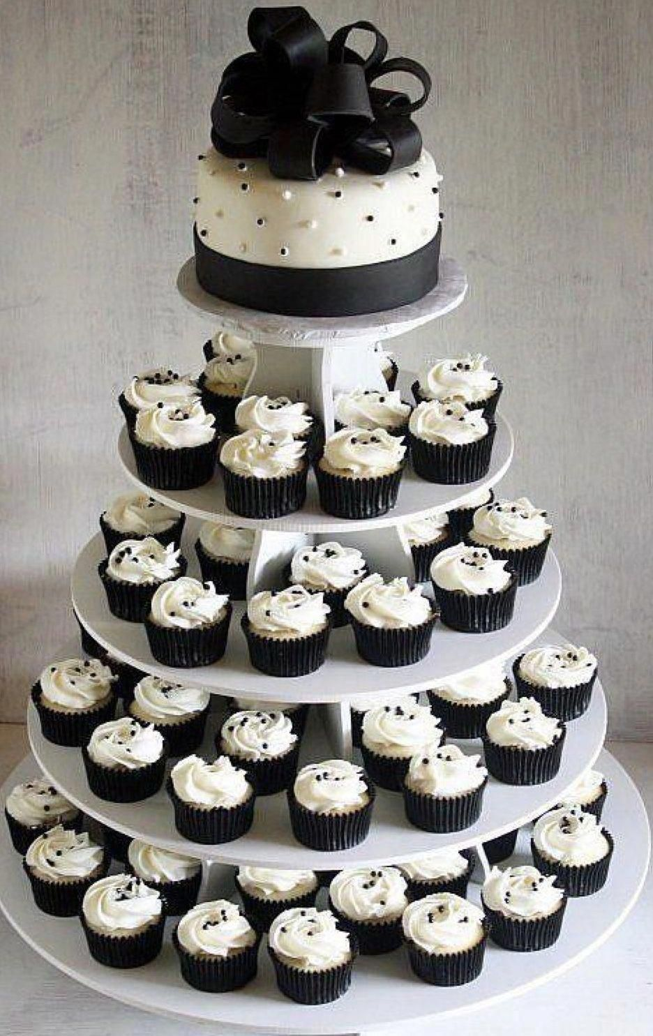 Usually Wedding Cakes Are Is The Conventional Cake Being Dished Up To The Visitor Cheap Wedding Cakes Black And White Wedding Cake Wedding Cakes With Cupcakes