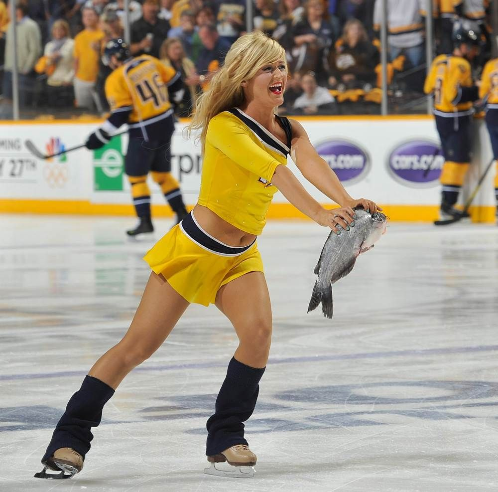 An Ice Girl Of The Nashville Predators Skates Away With A Catfish Thrown Onto The Ice By A Fan Against The Detr Ice Girls Detroit Red Wings Nashville Predators
