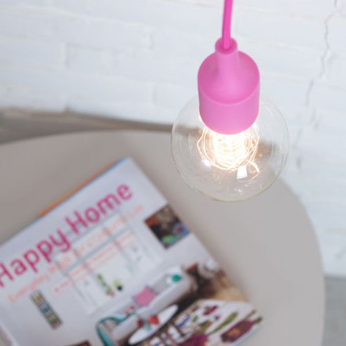 Fuchsia Pendent Lamp. A simple yet dominant lamp with a silicone rubber cap bulb holder, a fabric cord and a wall plug. The fuchsia pink cord is 3 meters - long enough for you to hang it in any way you want.