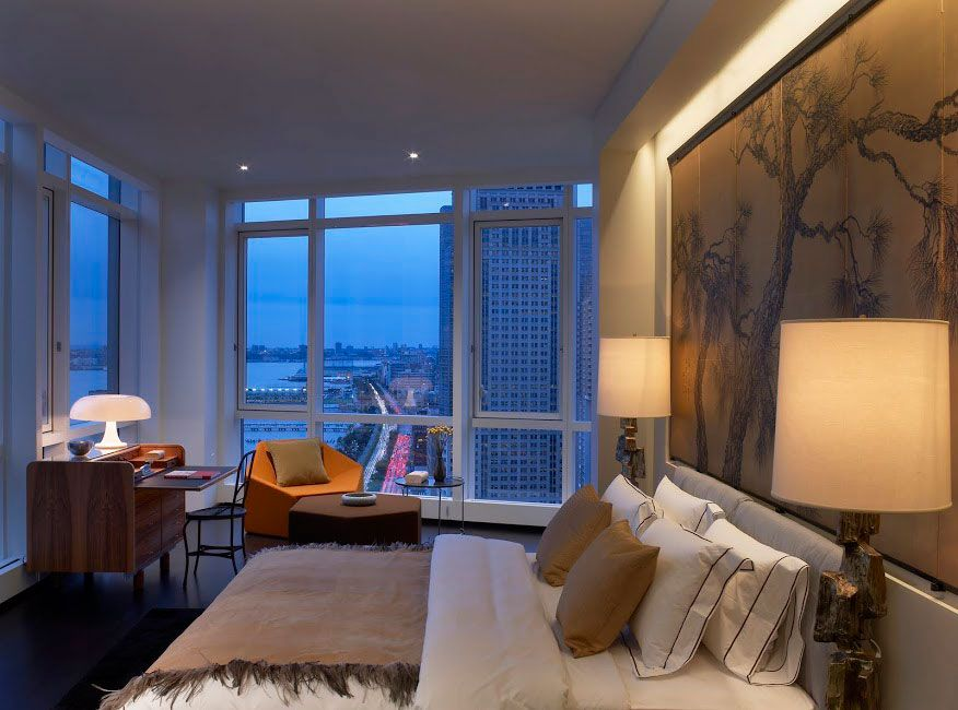 bedroom-penthouse-apartment-design-with-wooden-study-table-and-puff
