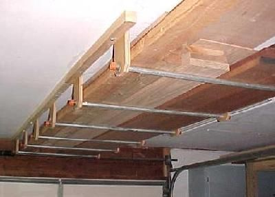 Use Of The Ceiling To Store Wood Lumber Storage Garage Ceiling