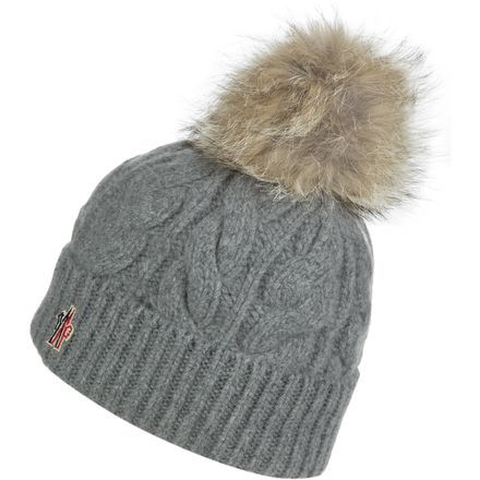 add63bcec17 Between the glittering sheen of fresh snow and the Moncler Women s Berretto Cable  Knit Pom Beanie