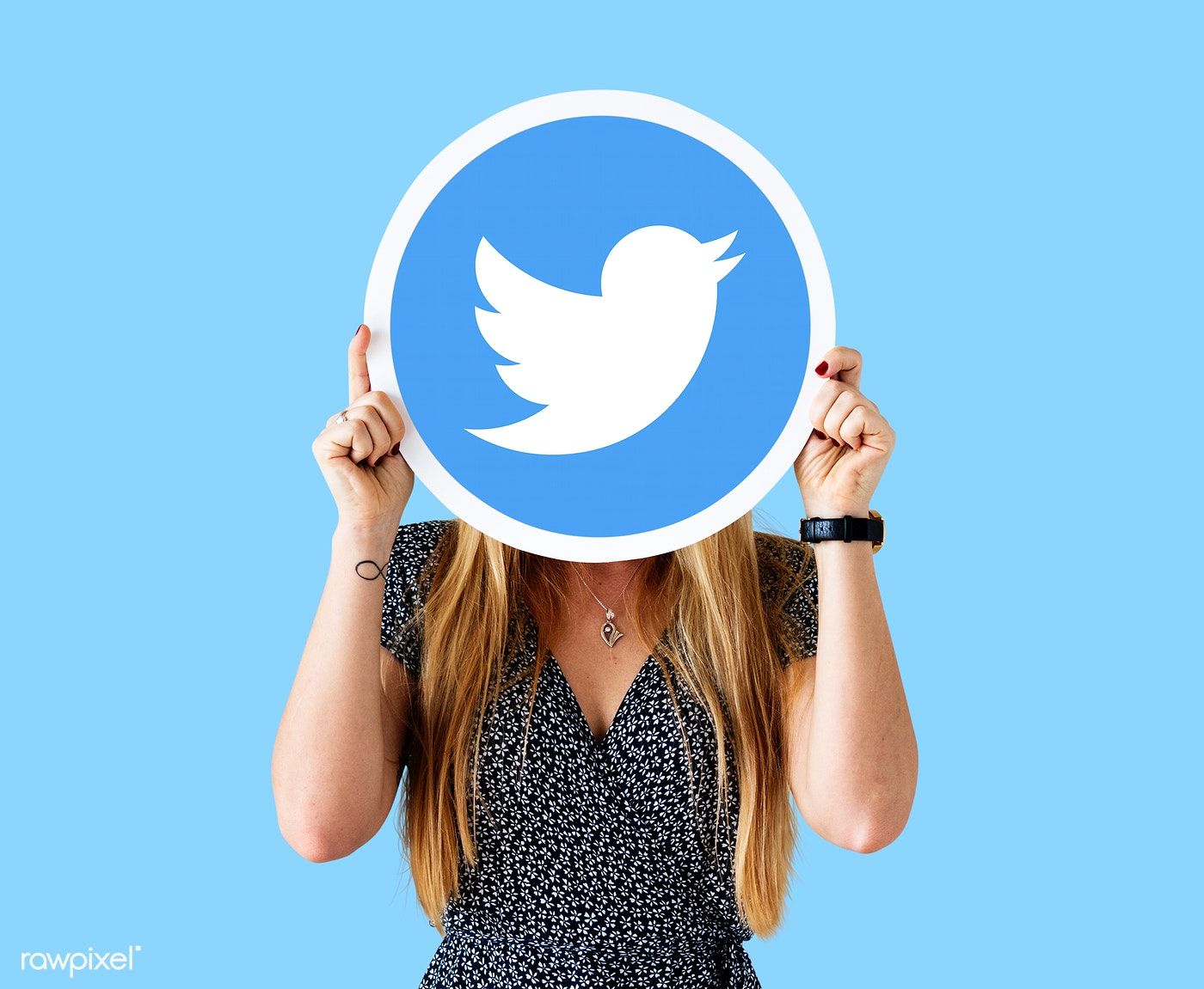 Woman showing a Twitter icon free image by
