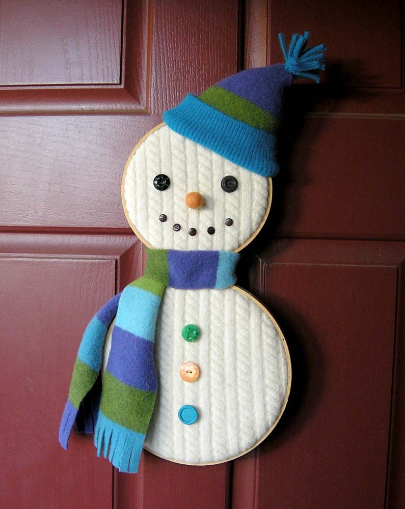 This cute snowman is made with an old sweater and embroidery hoops, which make it accessible and fun for everybody. Will you hang it on your door?