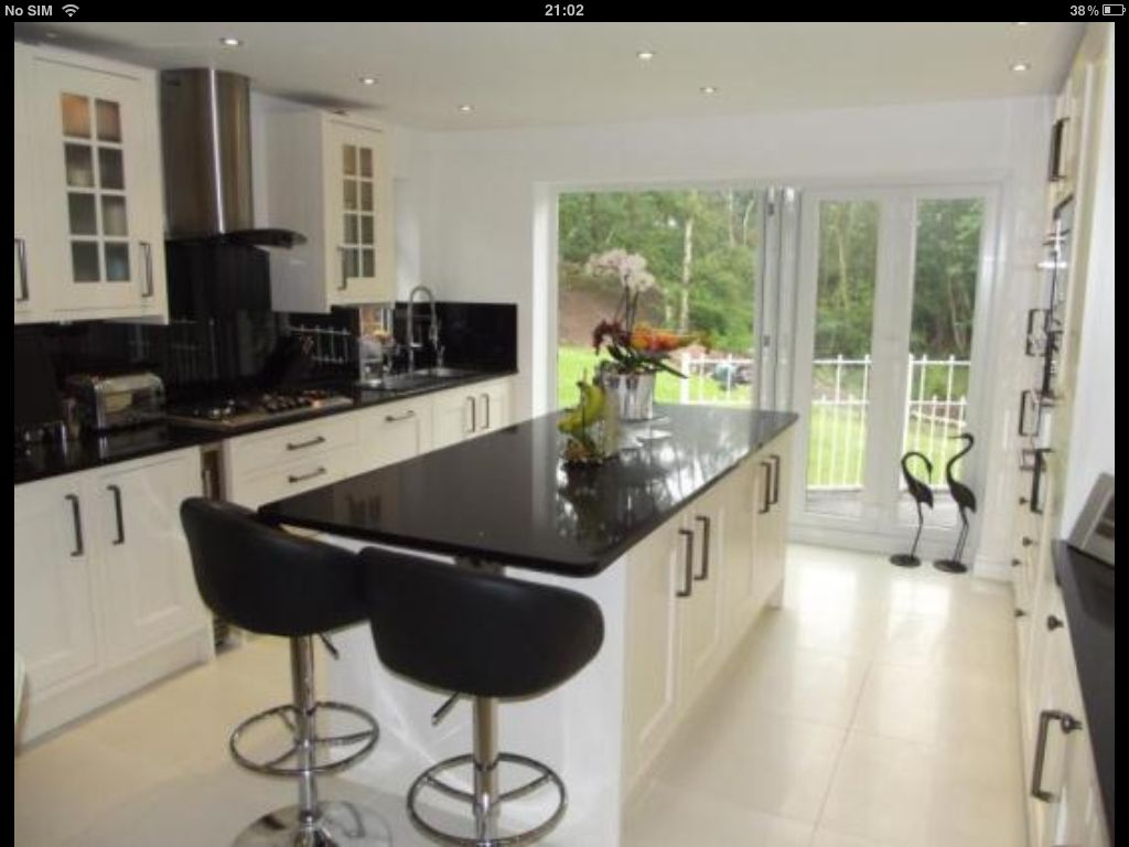 Cream And Black Kitchen With Island