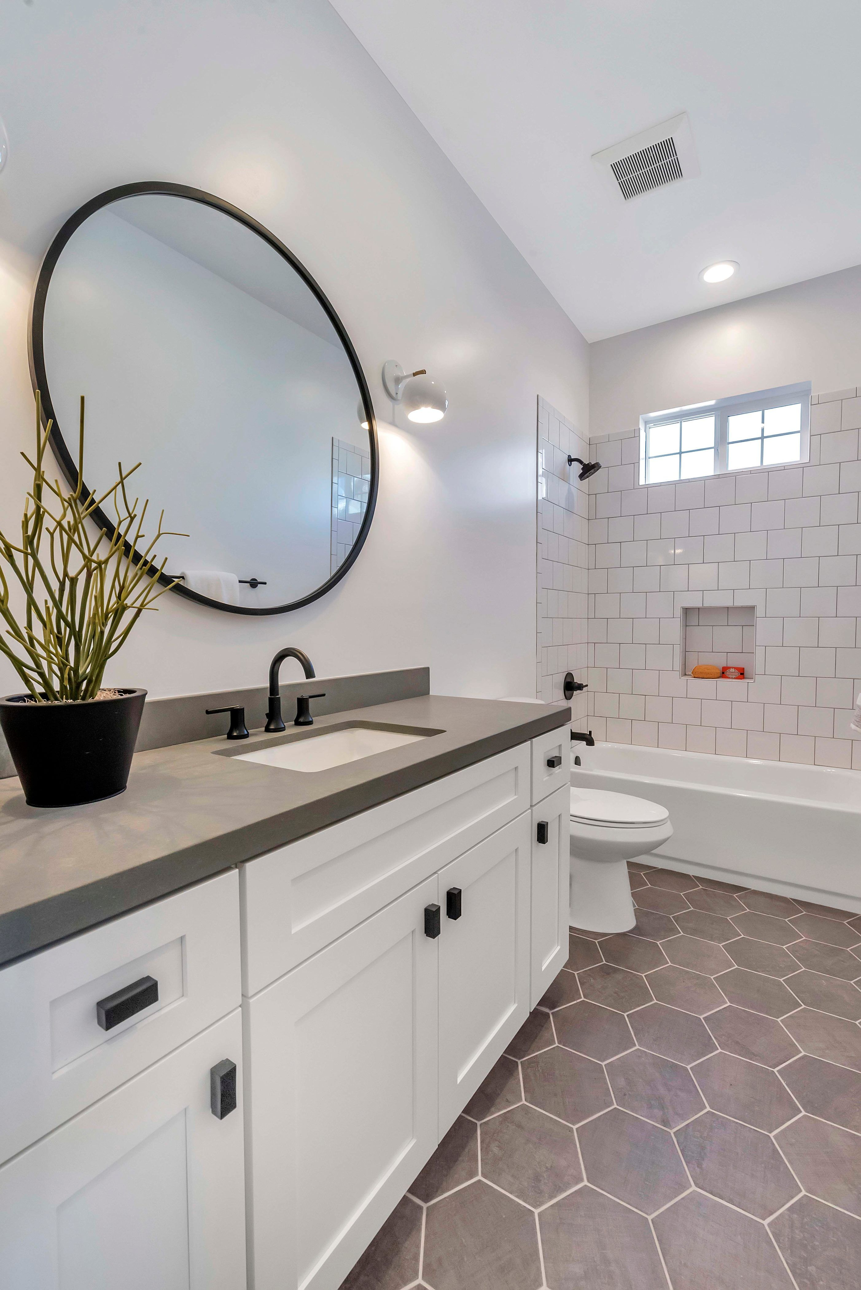 Shaker White Cabinets Are Great For A Bathroom Vanity With A Circle Mirror And Geometric Tile Floors Bathroom Mirror Bathroom Remodel Tile Trendy Bathroom