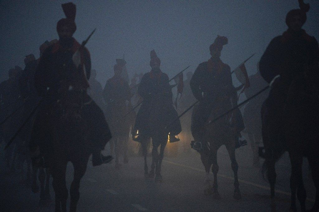 Members of the Presidential Guards on horseback rehearse for the forthcoming Republic Day parade on a foggy winter morning at Rajpath in New Delh...