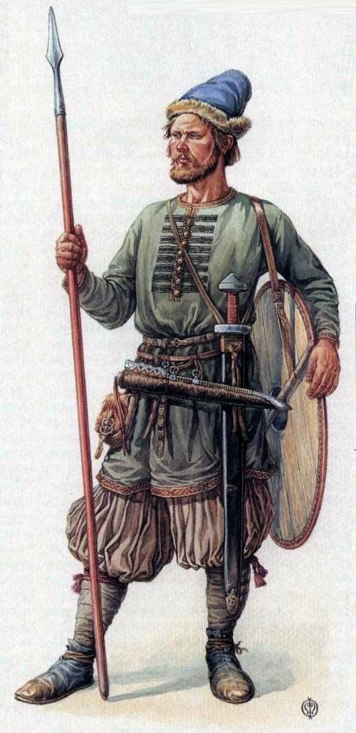 """Russian warrior.  The middle of the 10th c. Chernigov. Svyatoslavs troops could be dressed like this.. He has  one of the biggest  """"Carolingian type"""" sword (1 m 26 cm).Steppe axe.The belt, decorated with gold-plated silver plaques - Khazar-Magyar origin; sabertache, silk kaftan with scalloped gilt buckles give the Russian warrior image of eastern warrior. Reconstruction of Oleg Fedorov."""