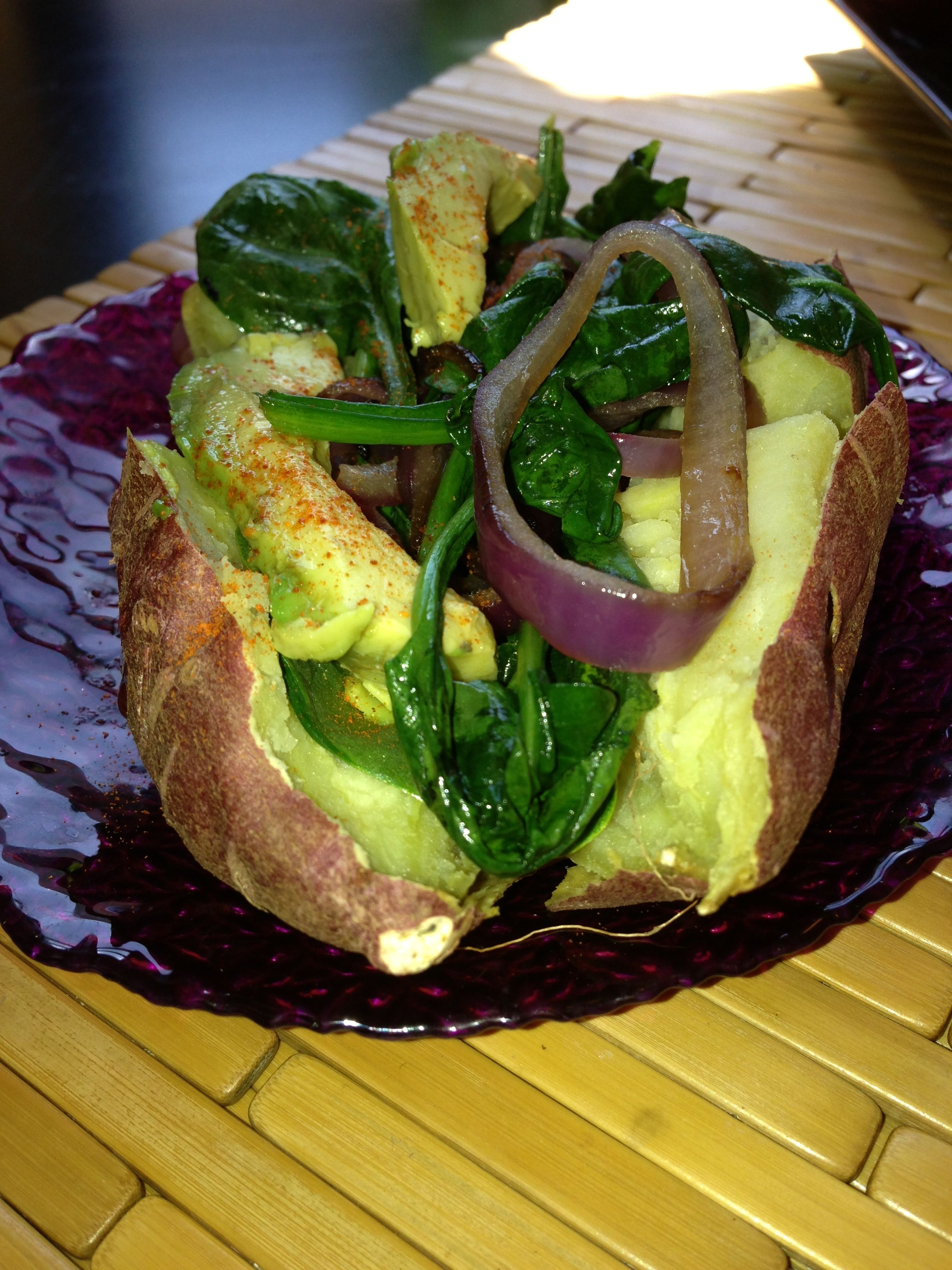Stuffed Japanese sweet potato with sauteed greens, onions