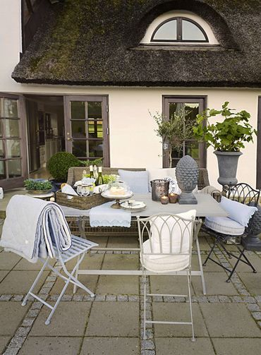 Outdoor » Lene Bjerre  I love the cozy blanket nice for for guests during cool evenings