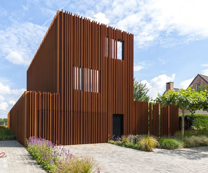 Rusted steel fins define the interior and exterior of the for Definition architecture