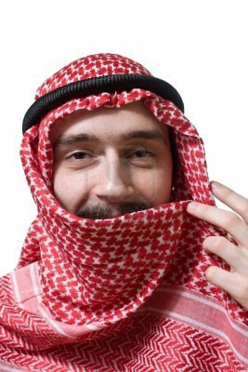 Portrait of smiling arabian young man in traditional headscarf