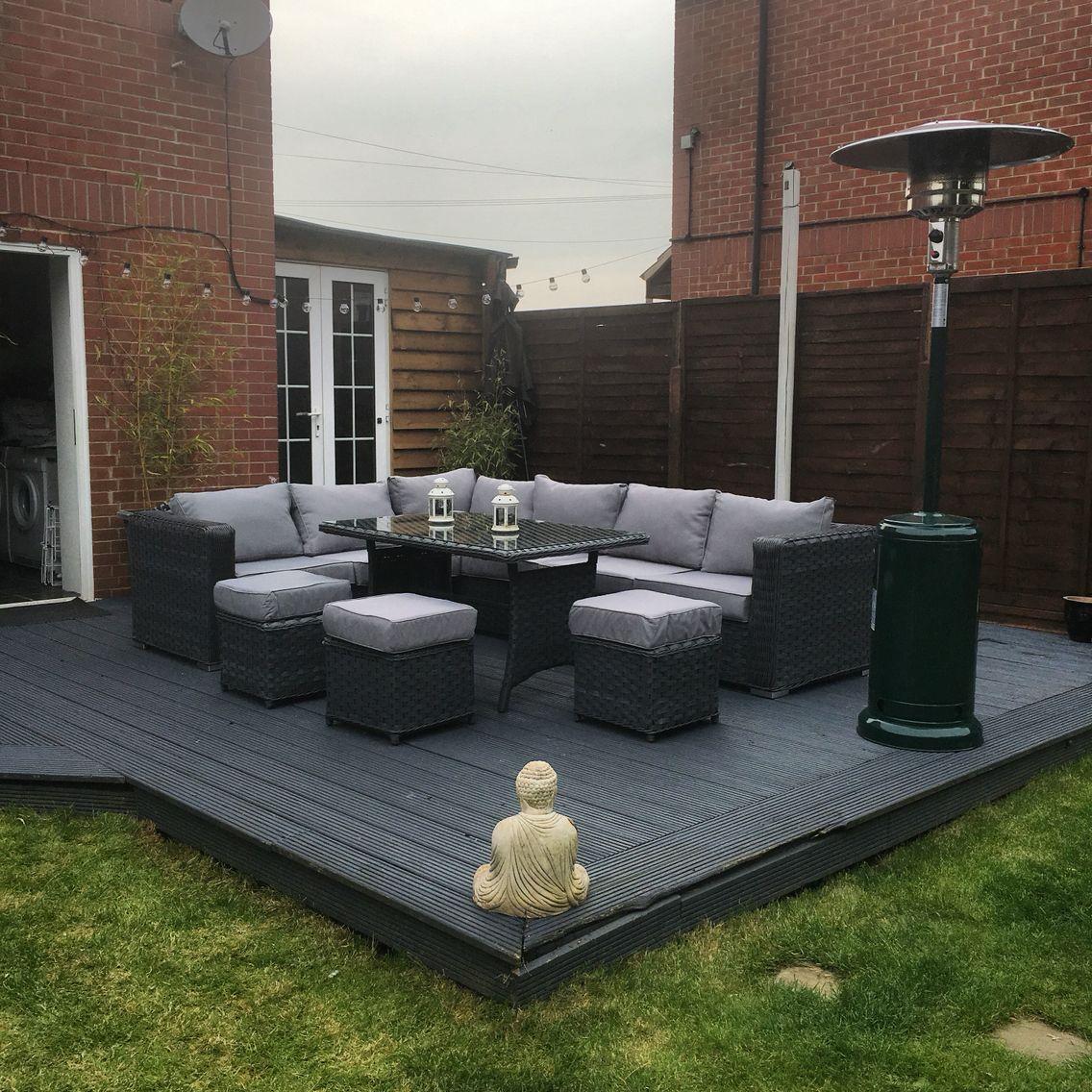 9 seater rattan garden furniture.. Grey decking.. Garden