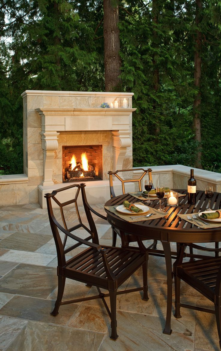 Outdoor fireplace in limestone and love the patio tile pattern too