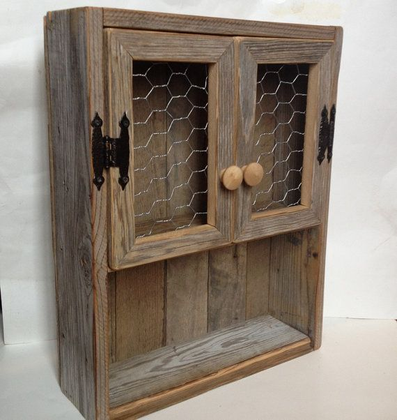 Rustic cabinet Reclaimed wood shelf Chicken wire decor Bathroom wall
