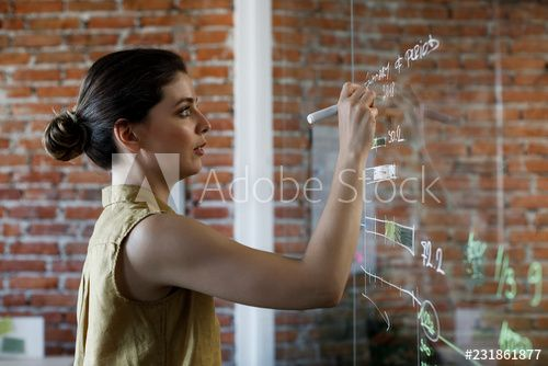 Beautiful young Caucasian businesswoman writing on glass board. , #SPONSORED, #Caucasian, #young, #Beautiful, #businesswoman, #board #Ad