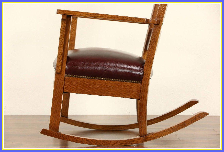 antique black wooden rocking chair