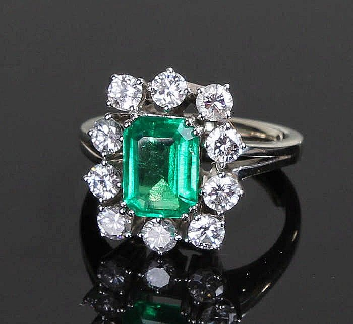 Fine Colombian emerald and diamond set ring, the central octagonal cut emerald…