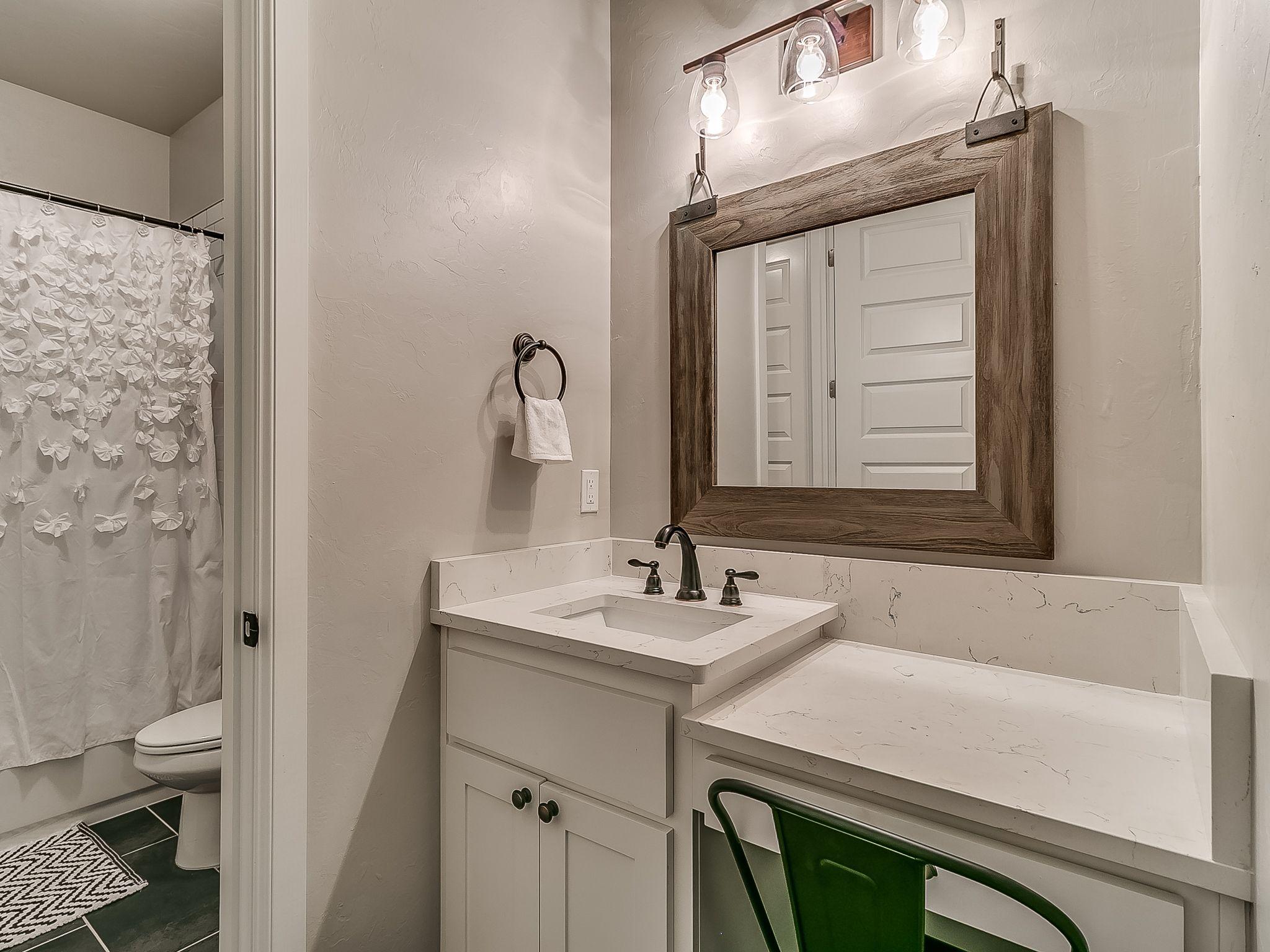this gorgeous jack  jill farmhouse bathroom is beautiful