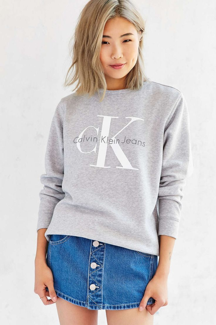 The Calvin Klein Jeans for UO sweatshirt in grey, an exclusive.