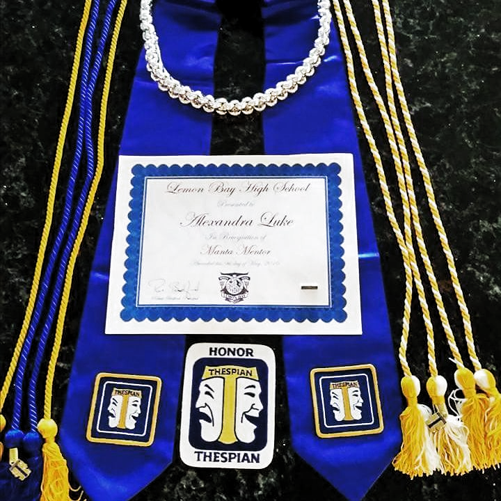 Graduating an honors thespian, got my international thespian society chords, scholar chords, my silver chord for community service... Im highly decorated haha #graduation #honors #thespian #ITS #internationalthespiansociety #chords #scholar #awards #vicepresident #troupe0257 #silver #blue #love #theatre #follow #l4l