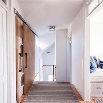 Laundry Room With Barn Door In Narrow Hallway By Laura Casale