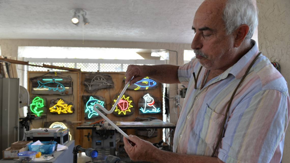 He crafted the Panther Coffee neon sign — and his work