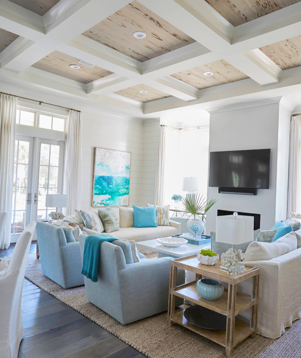 Cozy white and blue beach house style living room decor with slipcovered sofas coastal living room #beachhouse #coastal #coastaldecor