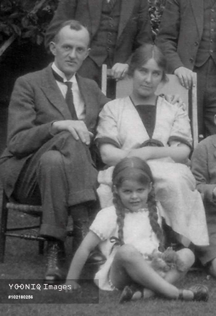 Helen Grace Culverwell Marsh-Lambert (1888-1981), prolific illustrator of children's books, pictured with her husband Charles Lambert and daughter Barbara, taken in Chiswick, west London.