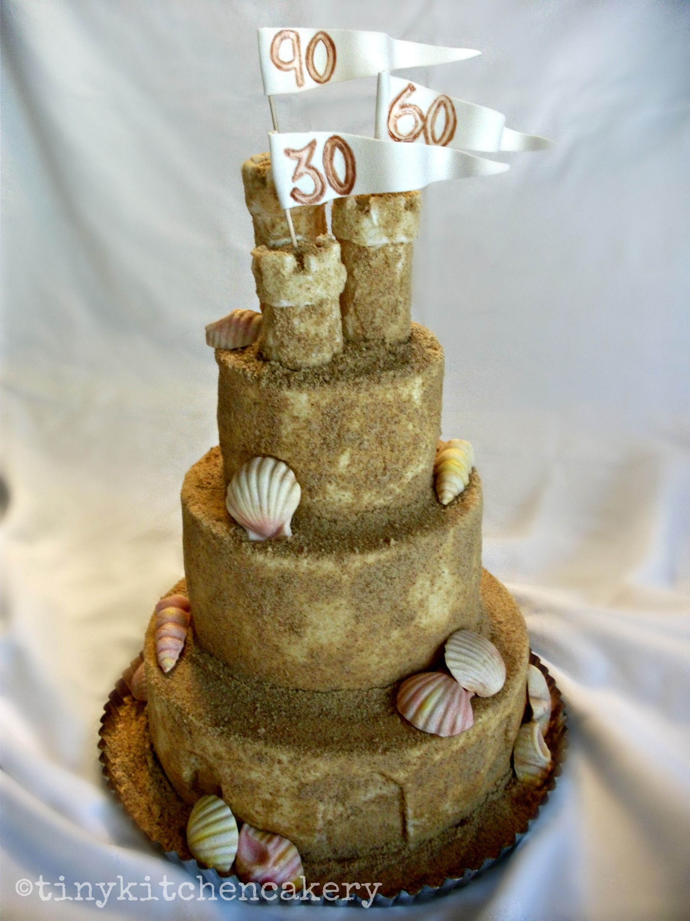 beach sand castle cake - three tiered cake with edible sea shells