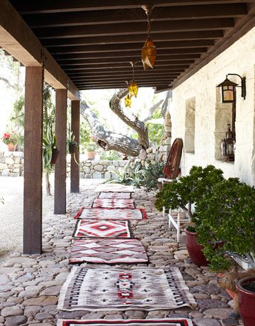 Southern Cali farmhouse porch with antique Navajo rugs