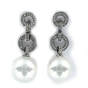 40996eec0fa9 Pendiente de circonita dos aritos entrelazados con perla de 12 mm y presión
