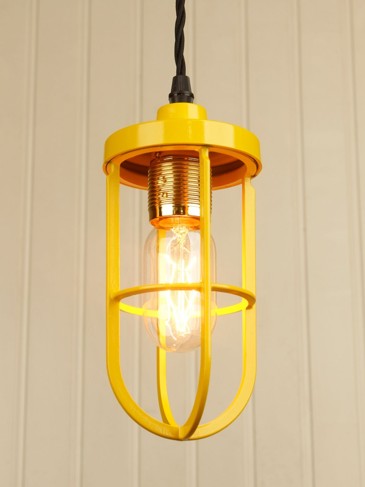 Industrial style ceiling pendant light with a yellow cage shade and
