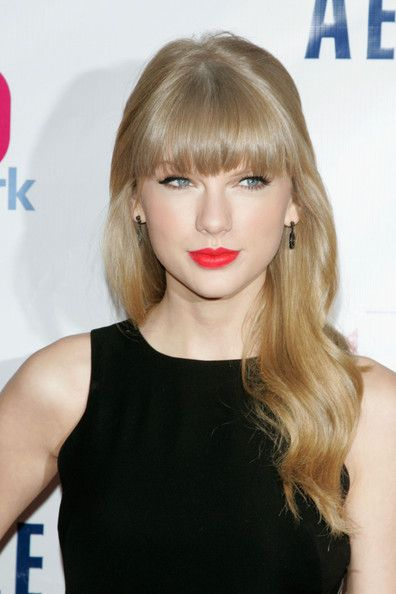 Taylor Swift Long Wavy Cut with Bangs - Taylor Swift Hair - StyleBistro