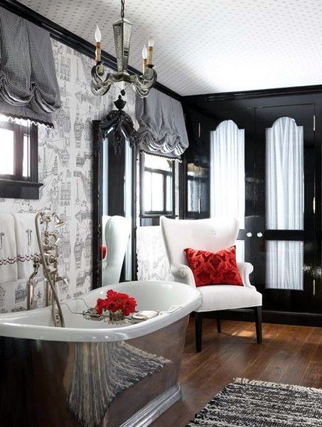 Wide plank hardwood looks amazing with black & gray decor, dramatic window valances, art deco french doors, pops of red and an antique-look steel bathtub.  Wow.