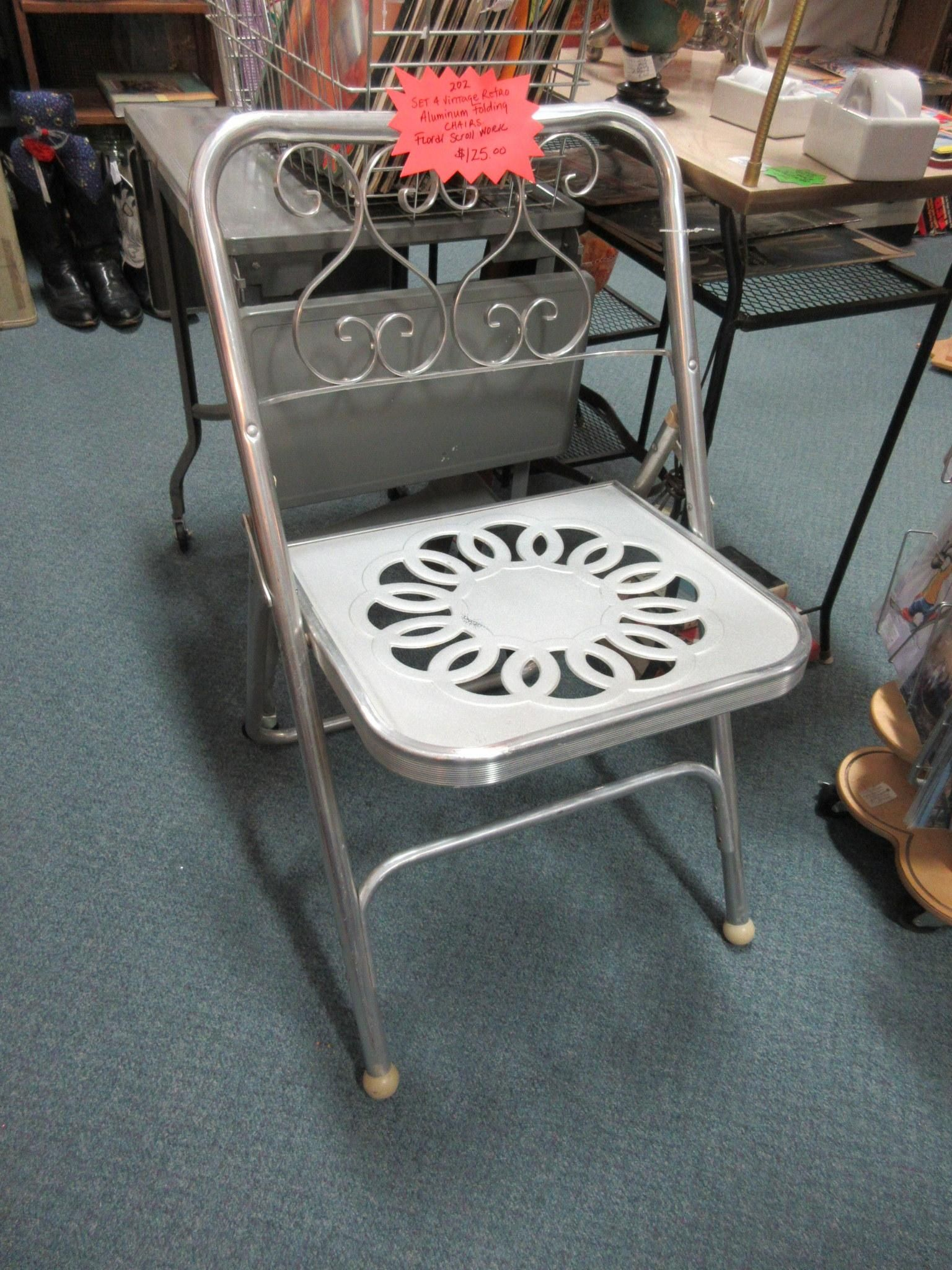 Set of 4 retro aluminum folding chairs From Vendor 202 in booth