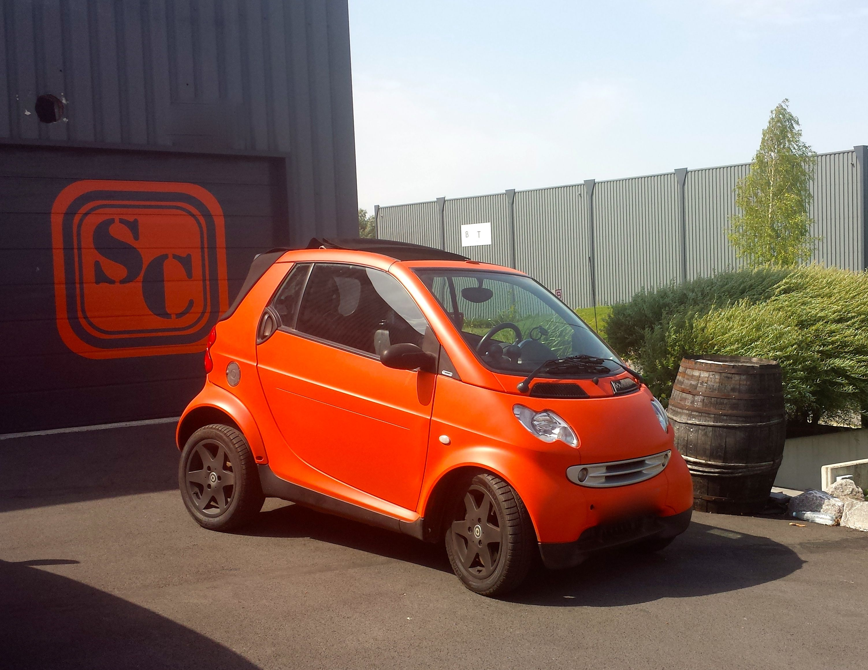 Smart car sticker designs - Smart Car Dipped With Blaze Orange Plasti Dip