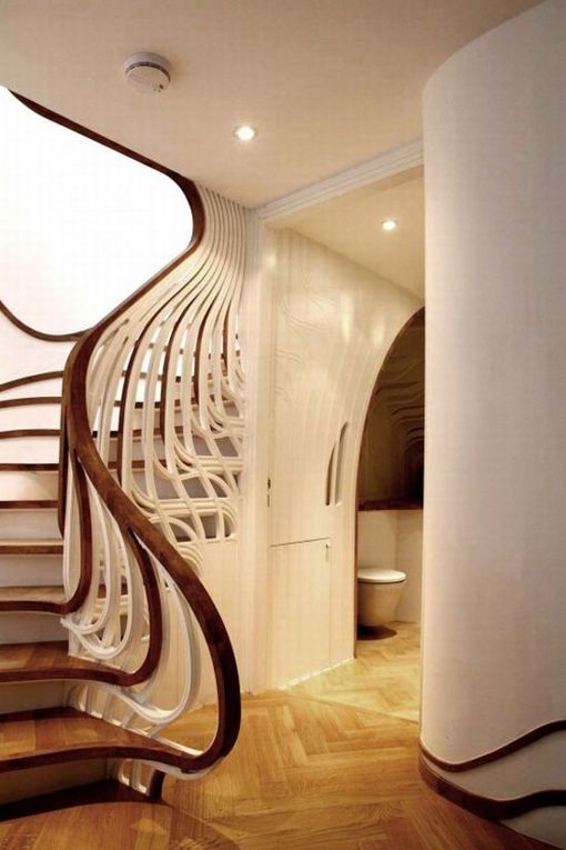 Gaudi-esque staircase design. Stairs roll into baluster to handrail and then up to landing above.
