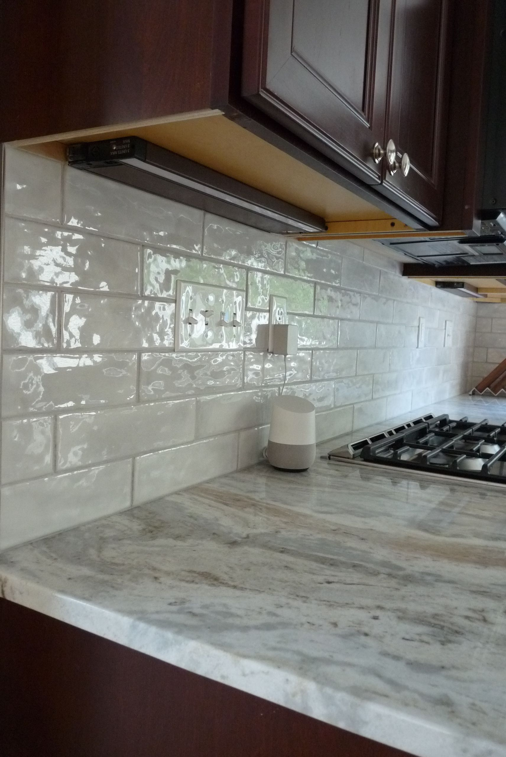The Brown Fantasy Granite Countertops Are Beautifully Complimented