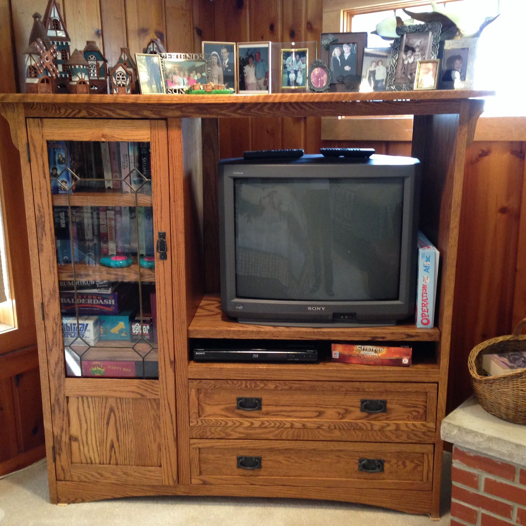 Entertainment cabinet in Lorijomary's Garage Sale in Nashotah , WI for . Opening for television, shelves behind door with leaded glass, two large drawers.